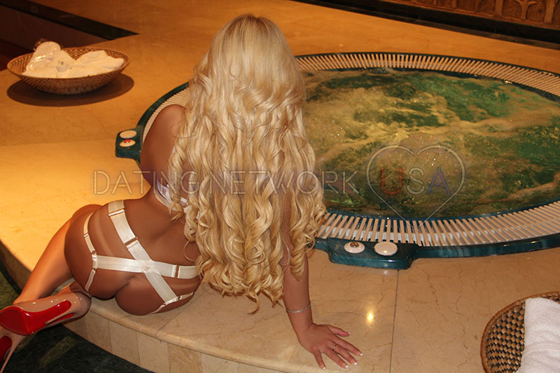 Her long blonde hair complements her body perfectly.